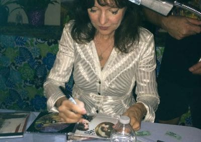 Harriet Schock signing CDs (photo by Kaci Christian)